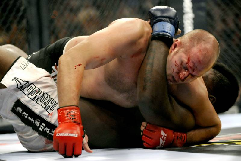 Fedor grapples with Brett Rogers in 2009.