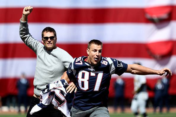 BOSTON, MA - APRIL 3: Rob Gronkowski of the New England Patriots steals Tom Brady's jersey before the opening day game between the Boston Red Sox and the Pittsburgh Pirates at Fenway Park on April 3, 2017 in Boston, Massachusetts. (Photo by Maddie Meyer/G