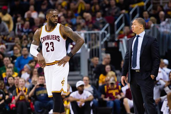 CLEVELAND, OH - FEBRUARY 11: LeBron James #23 talks with head coach Tyronn Lue of the Cleveland Cavaliers during the second half against the Denver Nuggets at Quicken Loans Arena on February 11, 2017 in Cleveland, Ohio. The Cavaliers defeated the Nuggets