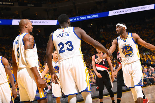 OAKLAND, CA - APRIL 19: Draymond Green #23 and Ian Clark #21 of the Golden State Warriors high five each other during the game against the Portland Trail Blazers during Game Two of the Western Conference Quarterfinals during the 2017 NBA Playoffs on April