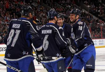 Gaborik celebrates a goal with teammates