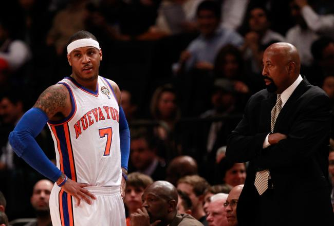Carmelo Anthony and his new head coach Mike Woodson confer during tonight's game.