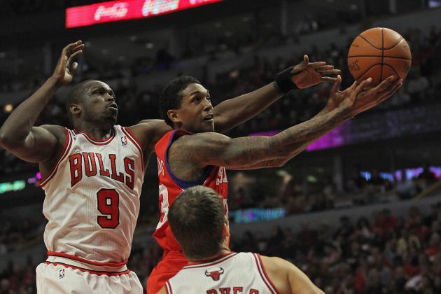 Derrick Rose Injured as Chicago Bulls Beat Philadelphia 76ers in Game 1