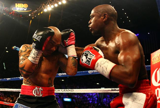 Mayweather smokes Cotto with a right.
