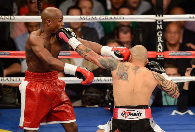 Cotto makes Mayweather blink.
