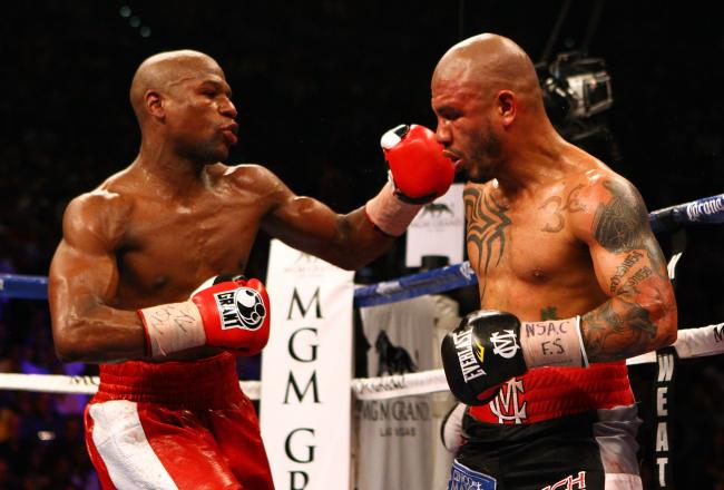 Mayweather smacks Cotto and began taking over in the championship rounds.