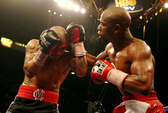 Mayweather was challenged and fought back-and put on a strong show.
