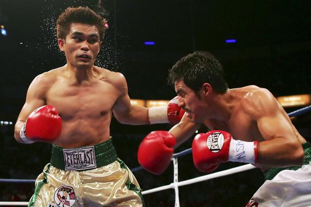 Brian Viloria TKOs Omar Romero in the 9th  to Retain WBO Flyweight Title