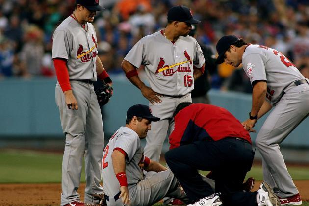 Berkman Injures Knee; Strasburg Leaves Early