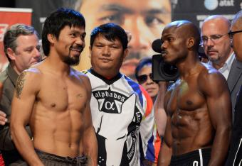 Manny Pacquiao smiling at a very serious Timothy Bradley