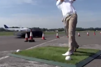 Watch a F1 Driver Catch a Golf Ball in His Car Going 180 Miles Per Hour