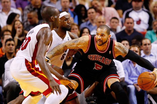 Taj Gibson or Carlos Boozer: Which One Deserves to Start for the Chicago Bulls?