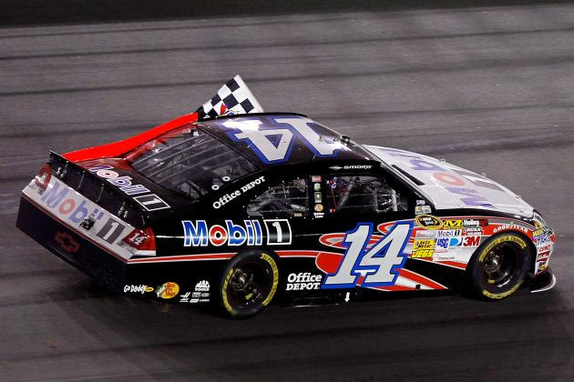 Tony Stewart Manages Chaotic Win at Daytona