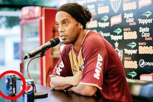 Ronaldinho drinks a Pepsi at press conference, loses $750,000