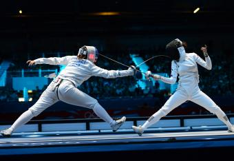 U.S. fencer Courtney Hurley, left, attempts to score a touch against Anna Sivkova of Russia in a bronze medal match.