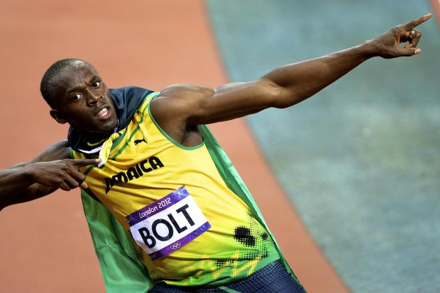 Usain Bolt 100-Meter Dash: Track Star's Gold Medal Celebration