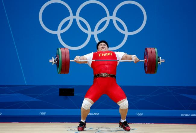 Lulu Zhou displays her strength in the snatch portion of the Women's +75 Kilograms class.