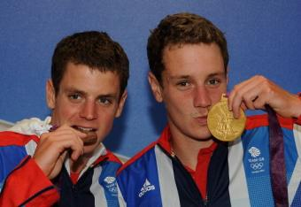 Great Britain's Jonathan Brownlee, left, and older brother Alistair celebrate after medaling at the Men's Triathlon.