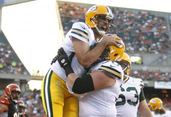 Aaron Rodgers celebrates a touchdown run.
