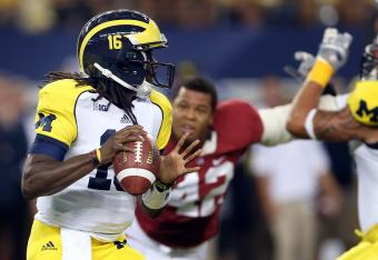 Denard Robinson is trying to make things happen for Michigan.