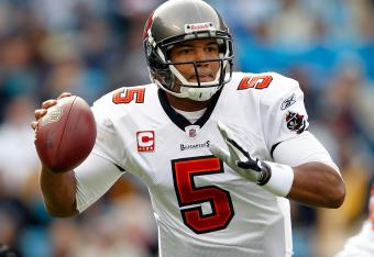 Josh Freeman picked the Panthers apart in the first half.