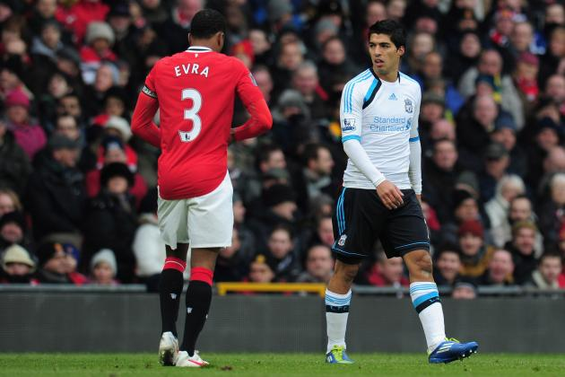 Patrice Evra and Luis Suarez Need to Put the Handshake Behind Them