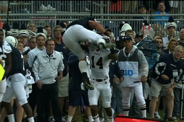 Penn State RB Mike Zordich Tries to Hurdle Defender