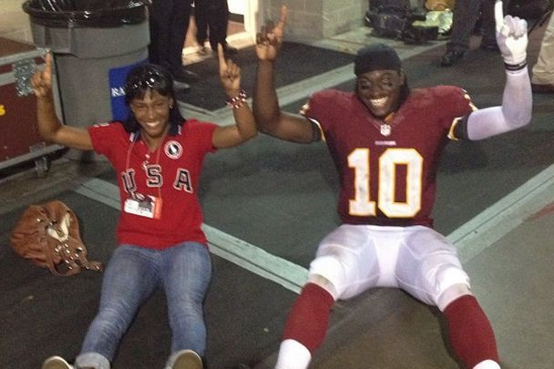 RGIII 'Griffining' with a fan after win in Tampa Bay
