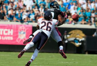Tim Jennings breaks up a pass intended for Mike Thomas