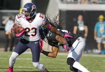 Devin Hester pulls away from a Jacksonville defender