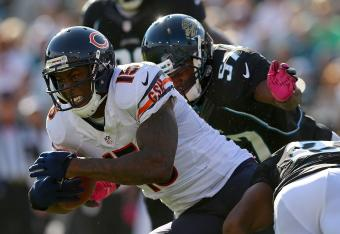 Brandon Marshall fights for extra yardage on one of his 12 receptions in the game against Jacksonville.