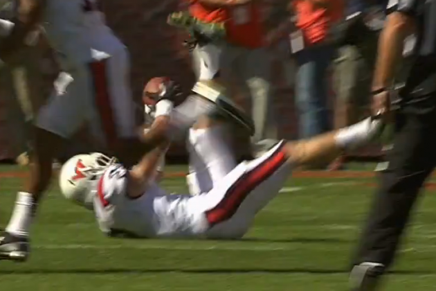 Video: Michael Cole Intercepts Tajh Boyd sitting down