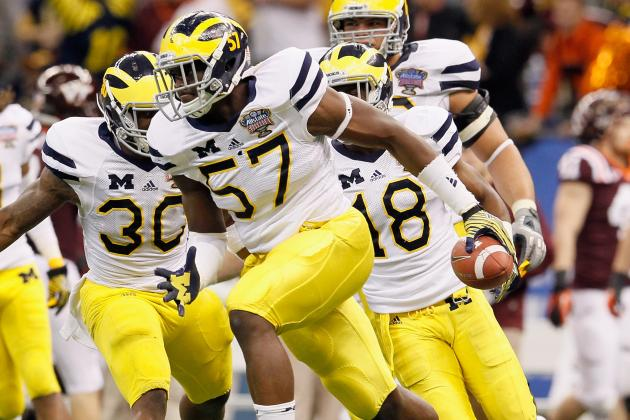 Michigan DE Clark out with Injury