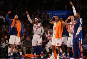 The New York Knicks celebrated a big win over the Miami Heat in their home opener.