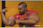 Guy with World's Biggest Biceps Says They're NOT Fake