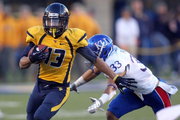 Smith throws for 40 TDs in season as WVU rolls