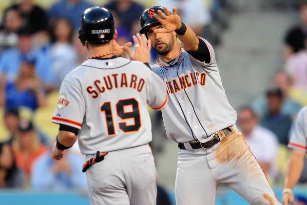 Pagan, Scutaro Pass Physicals, Sign the Deals They Wanted All Along