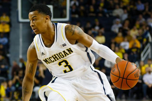 Trey Burke Shrugs off His Rim-Hanging Technical