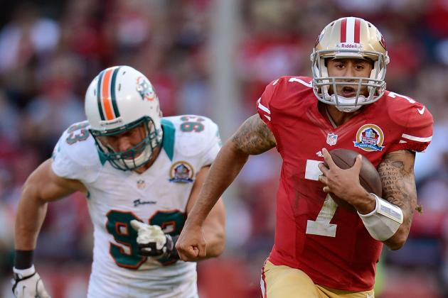 Colin Kaepernick Scores TD, Kisses Tats, Says Hi to Haters