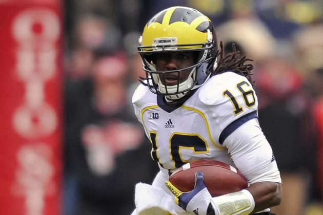 Michigan's Robinson Cited for Suspended License