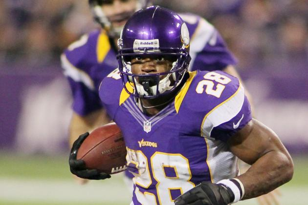 Adrian Peterson Passes 2,000-Yard Rushing Mark