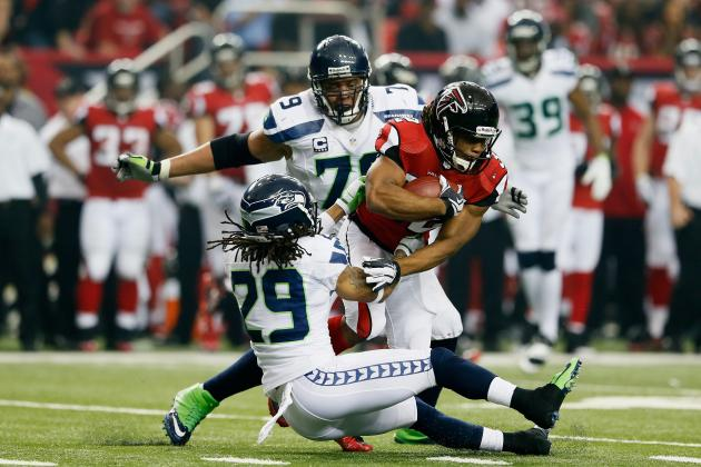 Seahawks vs. Falcons:  Jacquizz Rodgers Runs over Earl Thomas.