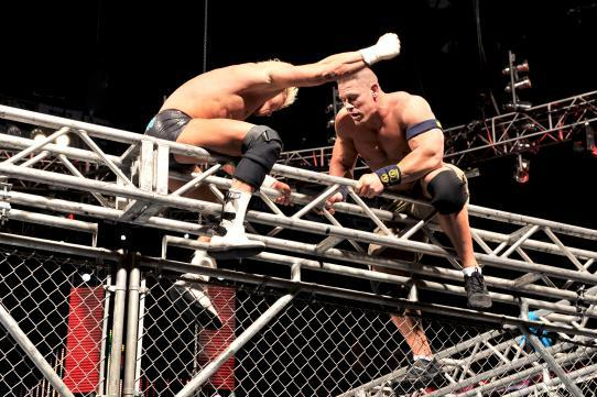 WWE Raw, Jan. 14: Cena Beats Ziggler in the Cage, Rock Brawls with Punk and More
