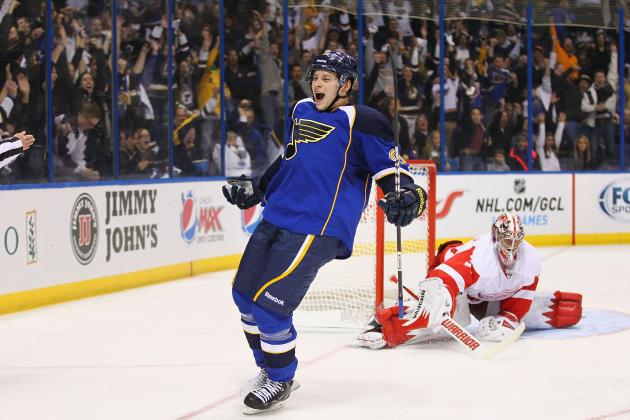 Blues overwhelm Red Wings in season opener