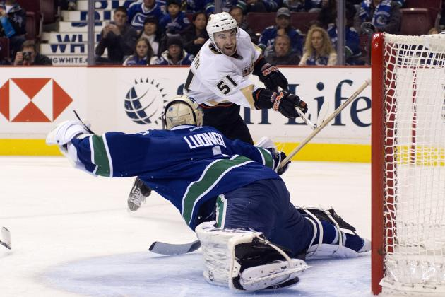Canucks bomb in 7-3 season opener loss with Schneider pulled in favour of Luongo