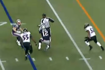 New England Patriots quarterback Tom Brady runs into referee