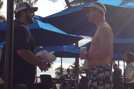 Here's Peyton Manning on Vacation Wearing $220 Swim Trunks