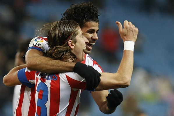 Soccer-Atletico ease into King's Cup semi-final with Sevilla