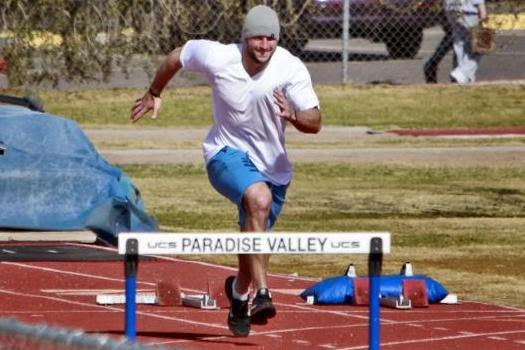Tim Tebow Gets Away from NY Jets Circus, Trains in Arizona