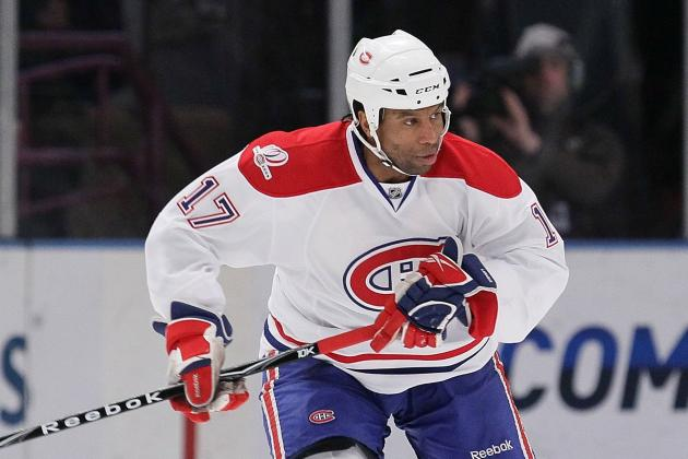 Ex-NHLer Laraque's House Raided by Police in Fraud Investigation